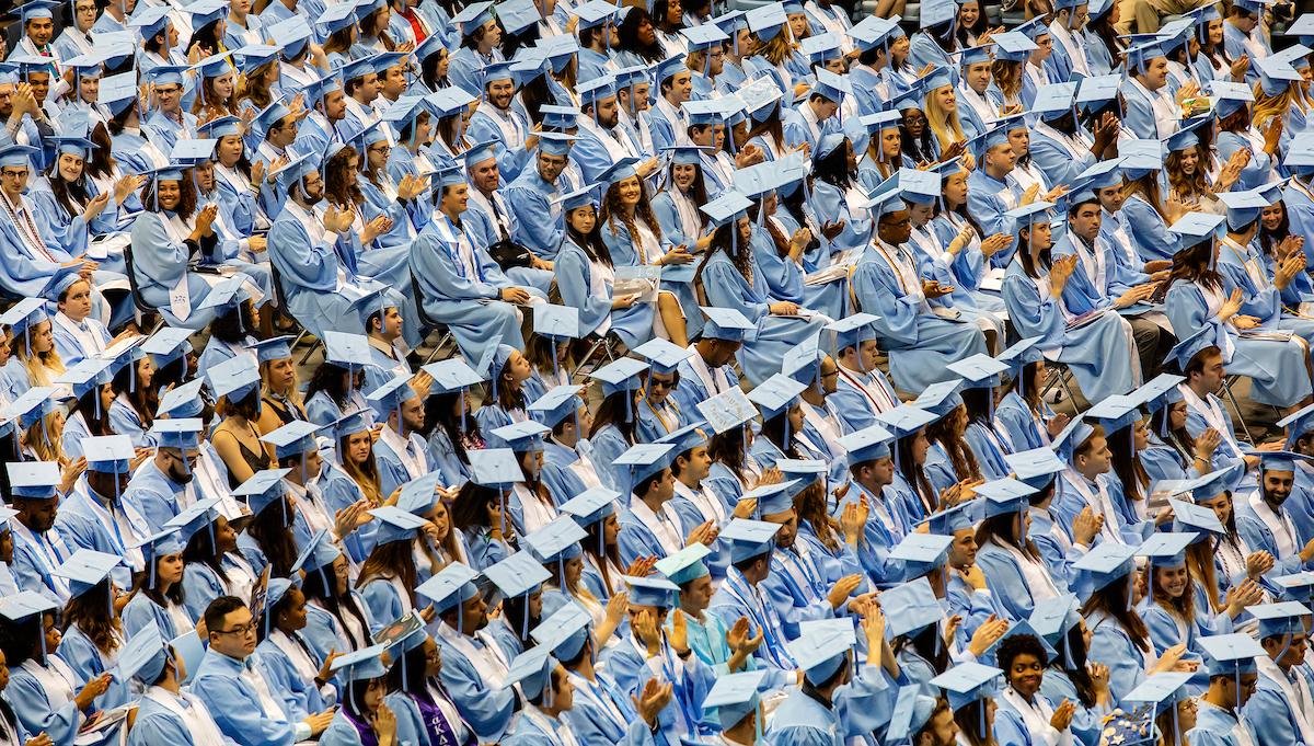 Graduates sit during the ceremony.