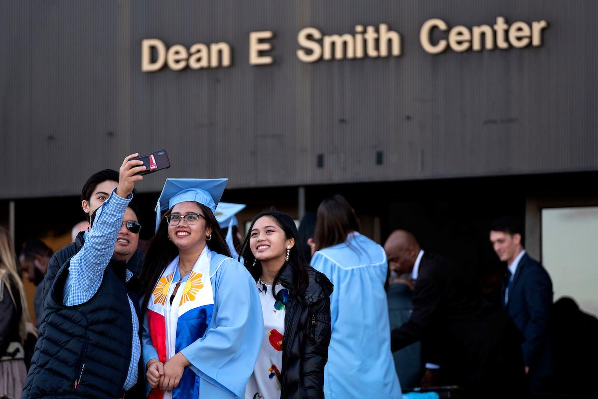 A family takes photos outside the Smith Center.