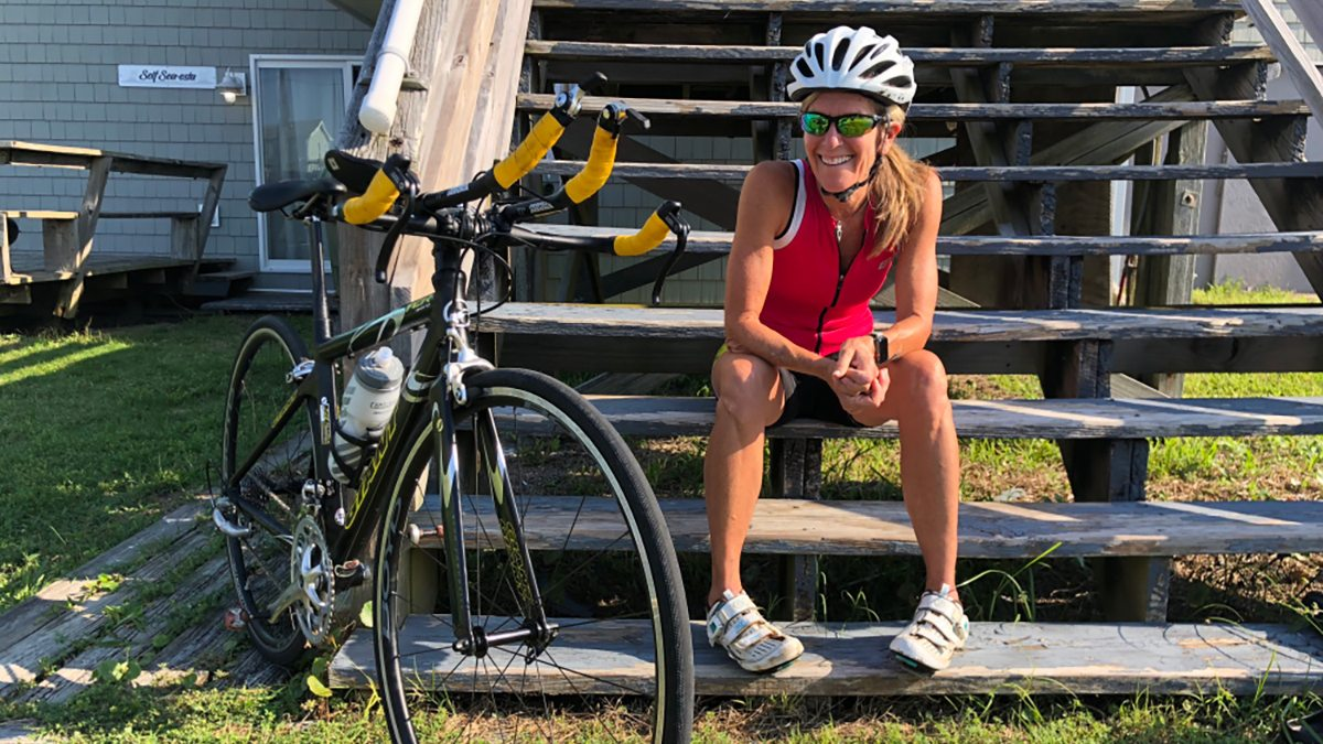 Molly Barker sits near her bike.