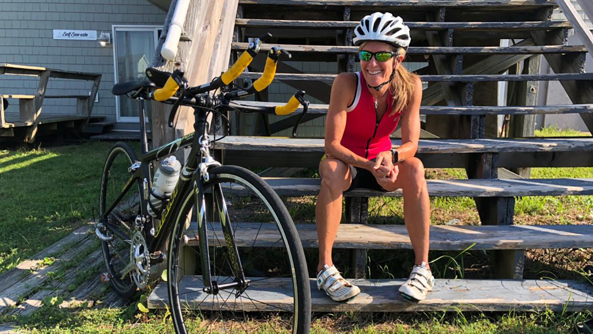 Molly Barker sits near her bike.