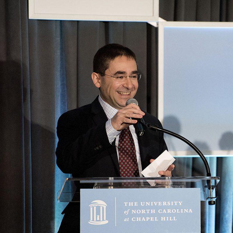 Fouad Abd-El-Khalick speaks at a podium.