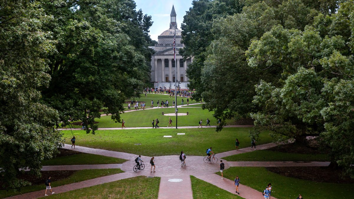 Aerial shot of students crossing Polk Place quad
