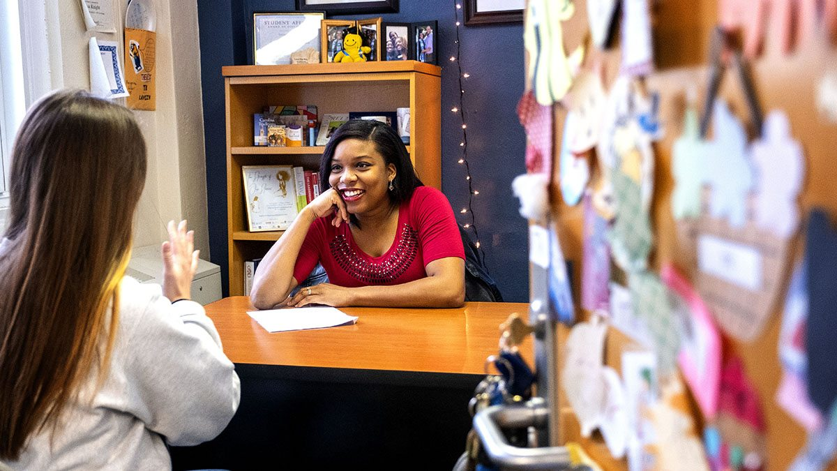 Theresa McKire talks with a student.