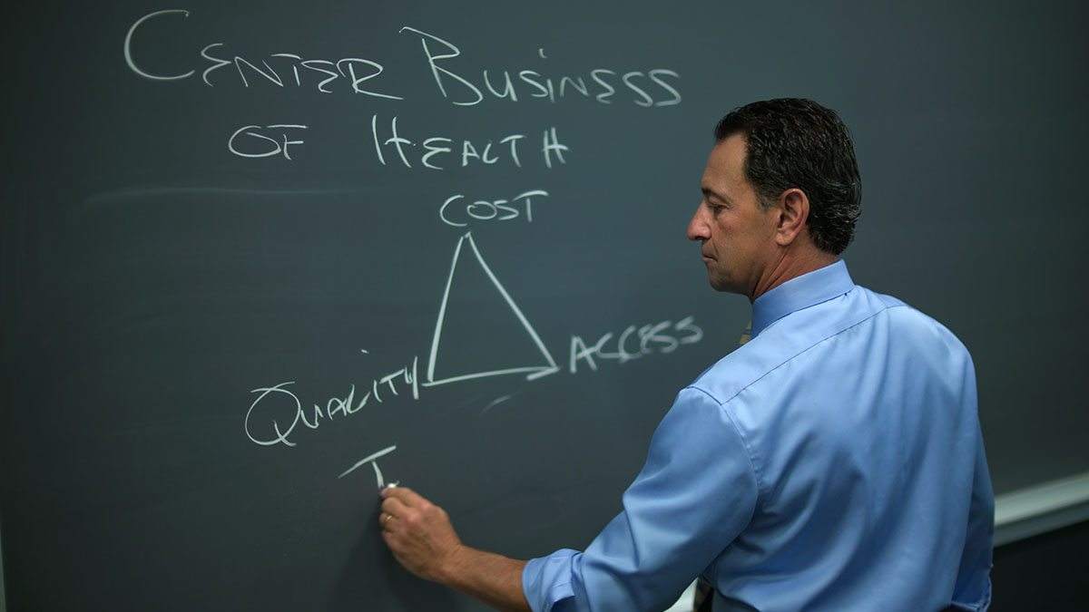 Markus Saba write on a chalkboard.