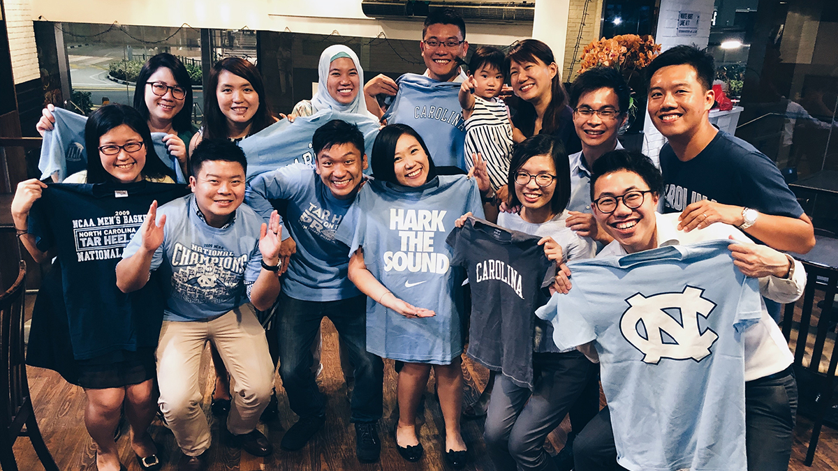NUS-UNC alumni show off their Carolina gear