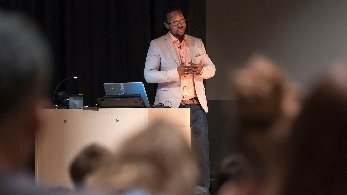 Dr. Ibram X. Kendi speaks on stage during the annual African-American History Month Lecture.