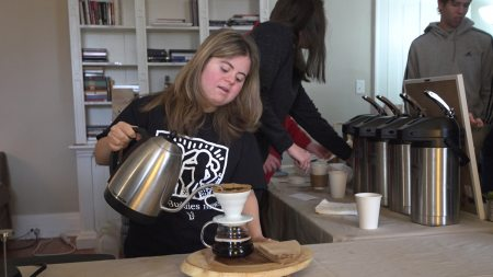 A baristra from Best Buddies Brews pours a cup of coffee.