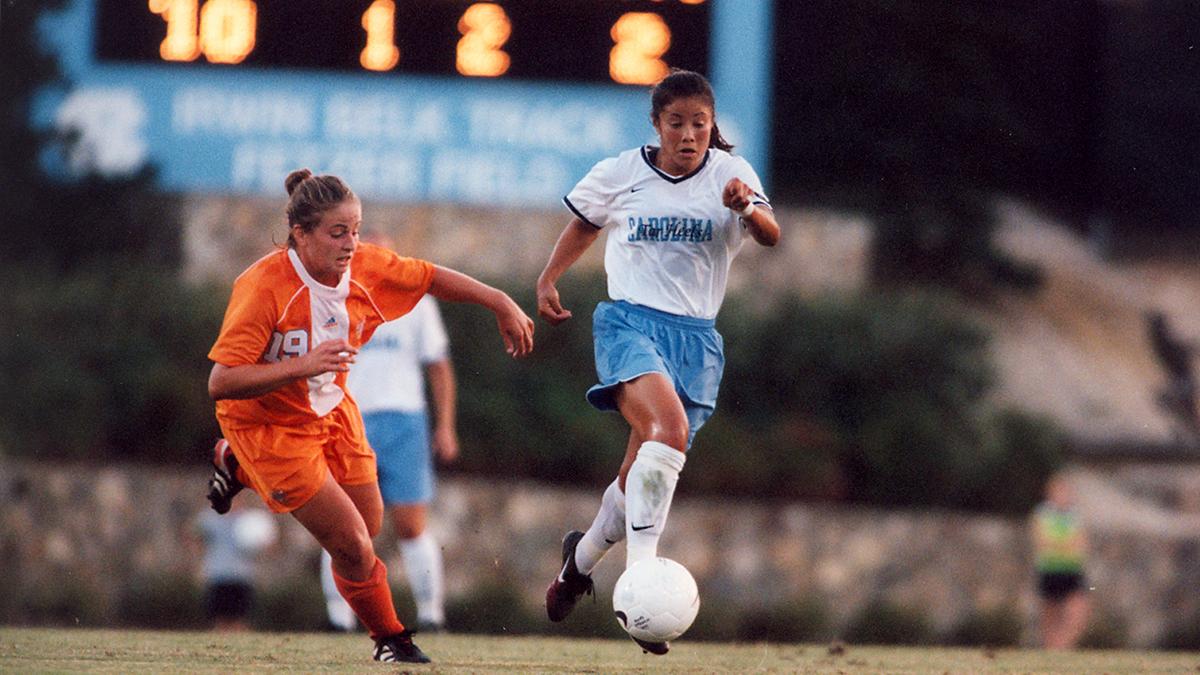 Lorrie Fair Allen plays soccer in 1998.