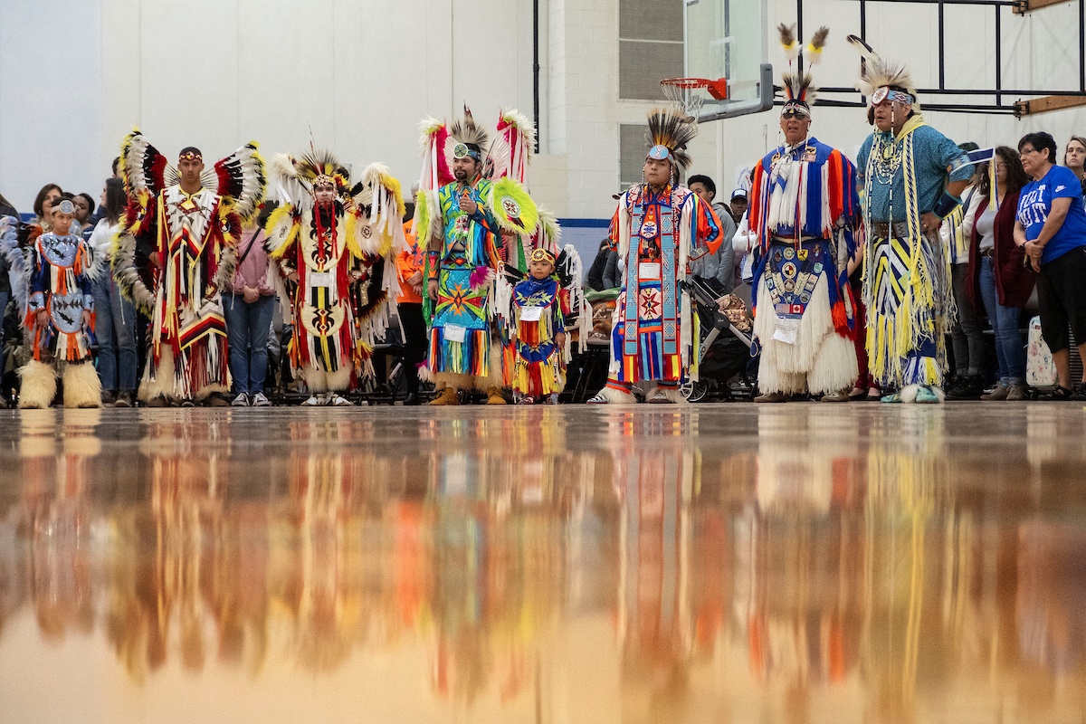 Powwow dancers await the start of the event.