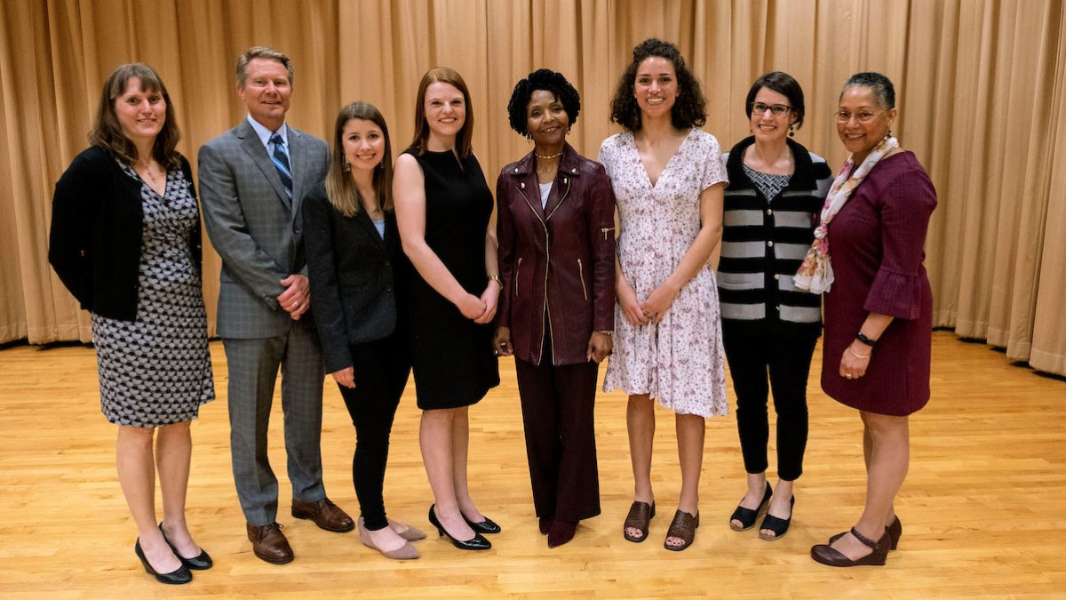 From right to left: Clare Counihan, program coordinator for faculty and staff at the Carolina Women's Center; Interim Chancellor Kevin M. Guskiewicz; Grace Langley; Jennifer Fulton; DeVetta Holman Copeland; Leah Bowers; Sarah Birken; and Gloria Thomas, director of the Carolina Women's Center.