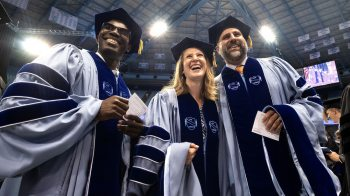 Three graduates at the Doctoral Hooding ceremony held May 12, 2018.