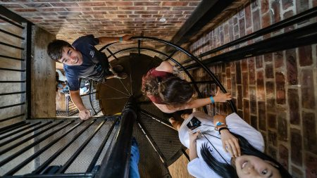 Student climb a spiral staircase