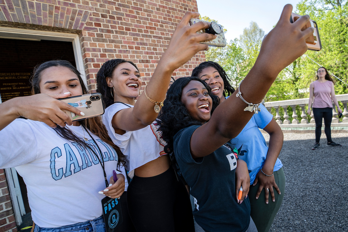 Students take a selfie at the Bell Tower.