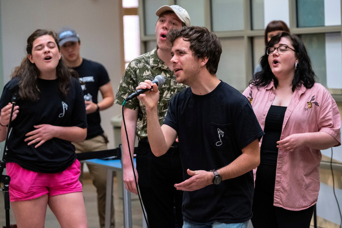 A student group sings in the Carolina Union.