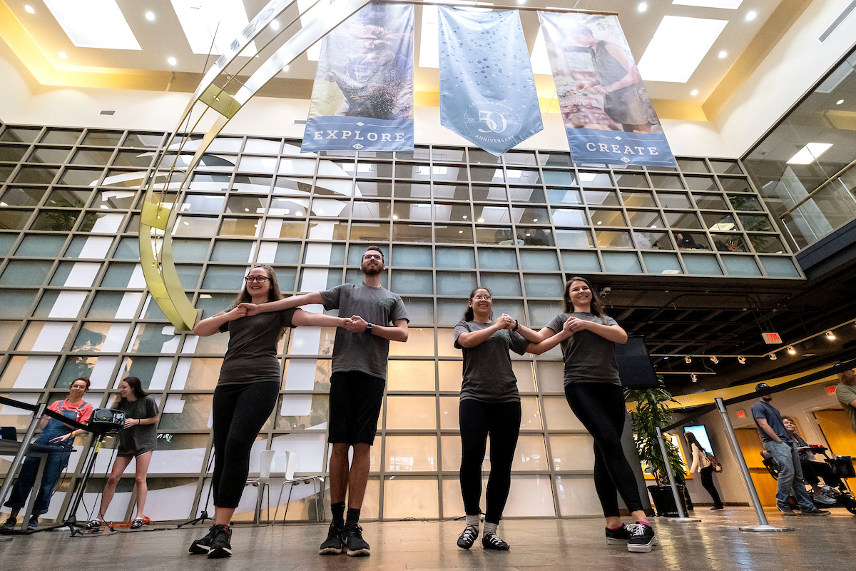 A student group dances in the Carolina Union.