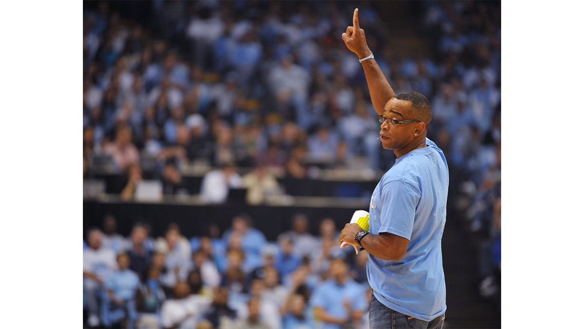 Stuart Scott stands on the court in the Dean Dome.