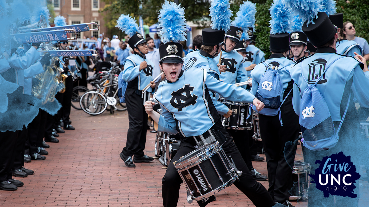 A marching band member plays the drums.