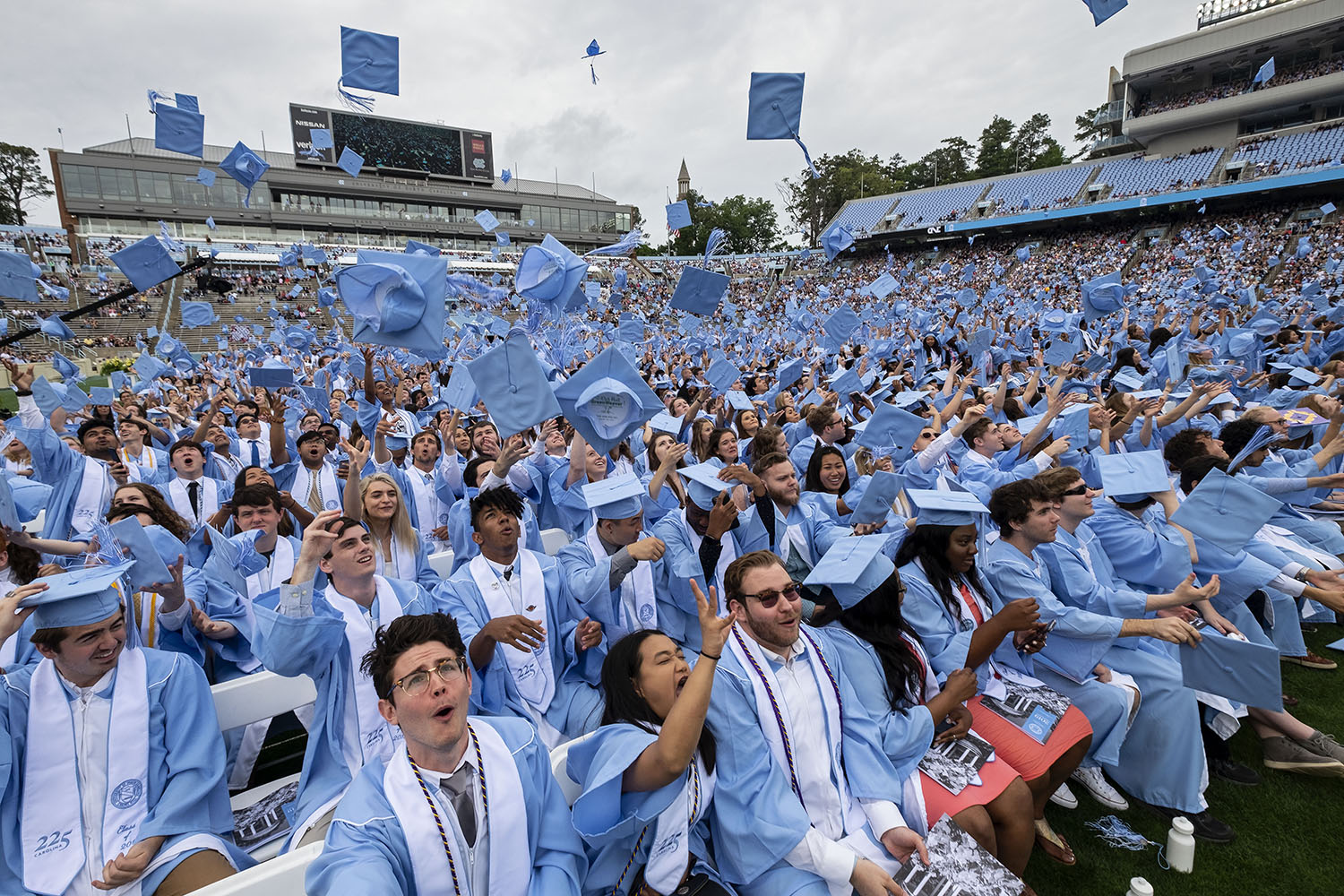 Students throw there graduation caps.