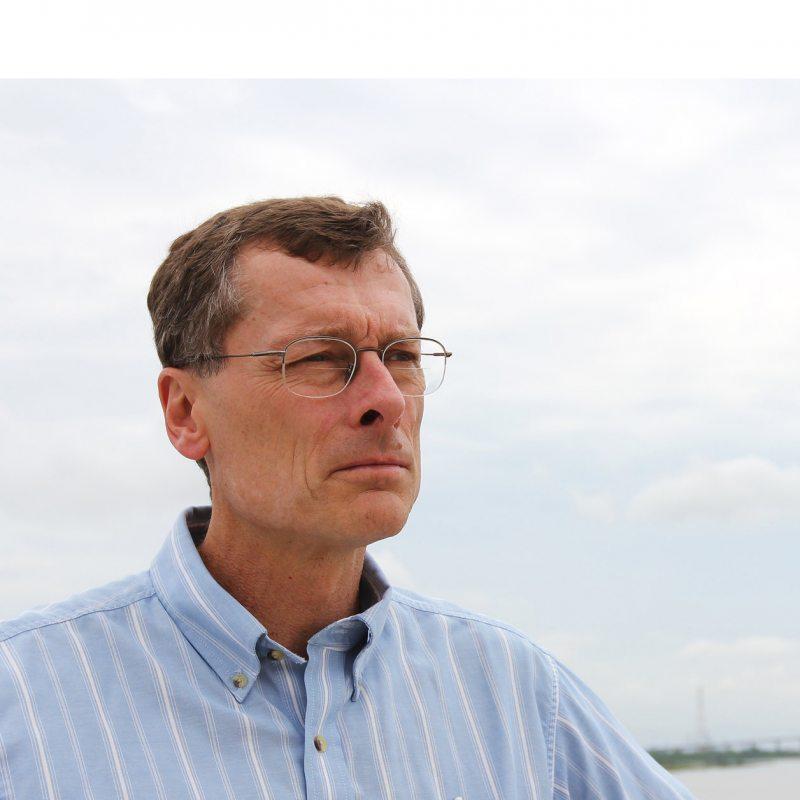 Rick Leuttich stands near the ocean.