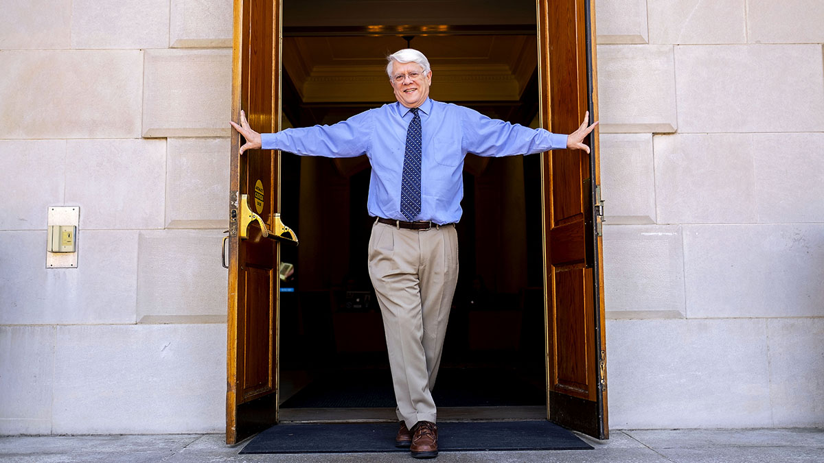Bob Anthony stands in the doorway of Wilson Library