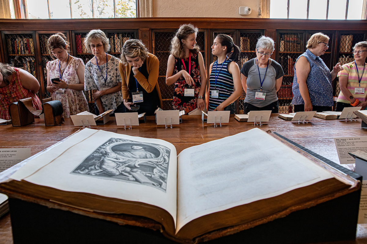 A group examines old books.