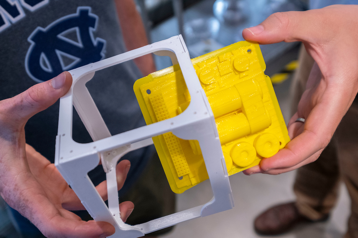 Close-up of yellow and white CubeSat model