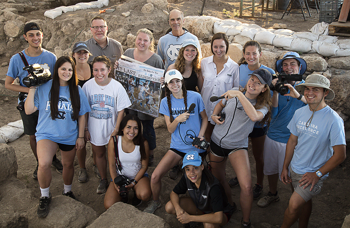 Students pose for a photo at the dig site.