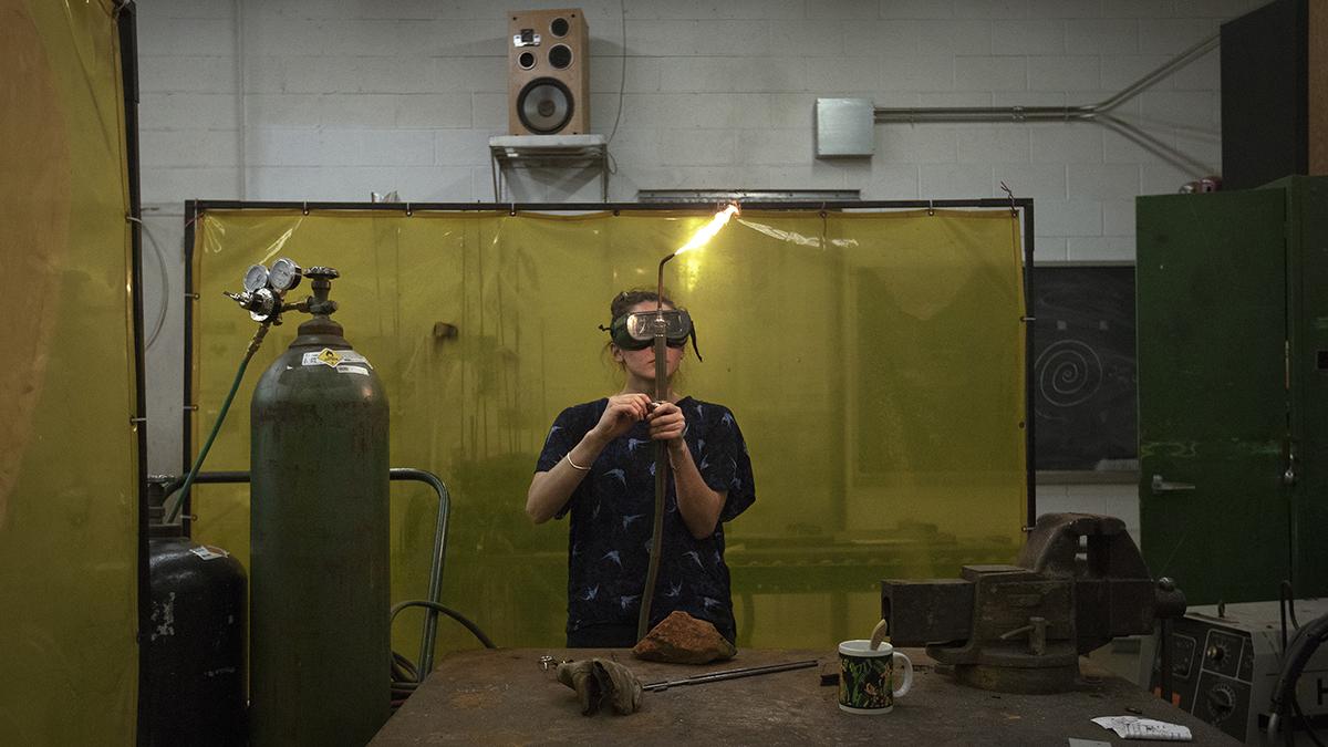 Ayla wearing welding goggles