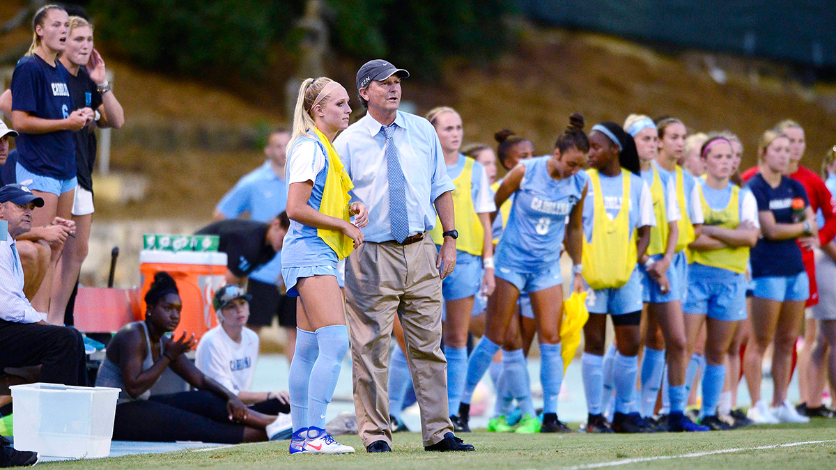 Anson Dorrance coaches from the sidelines.