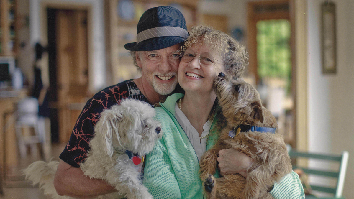 The Osbornes pose for the camera, each holding a dog