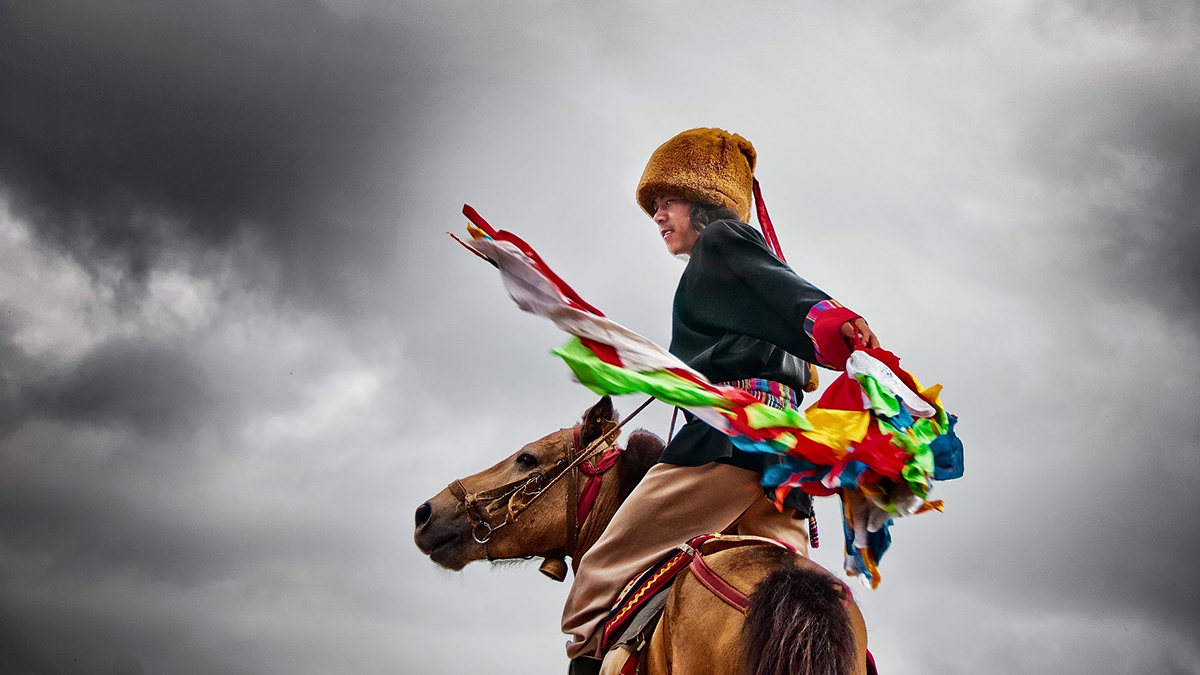 Little boy on a horse under stormy skies