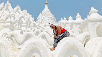 Mya Doggett in front of a white pagoda in Myanmar
