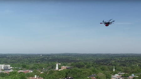 A drone flys over campus.