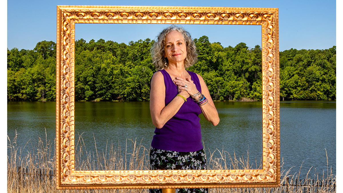 Karen Bluth poses for a photo near Jordan Lake.