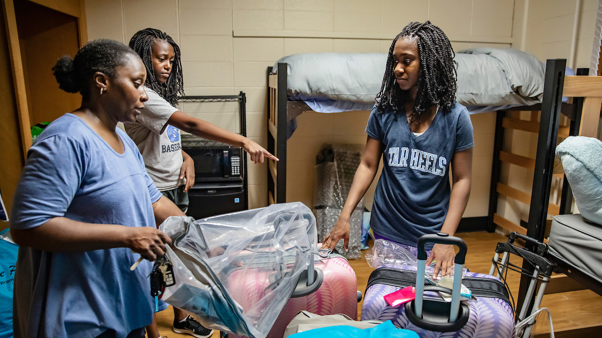 Students begin unpacking in the dorm rooms.