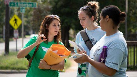 Three women talk during the Neighborhood Walk