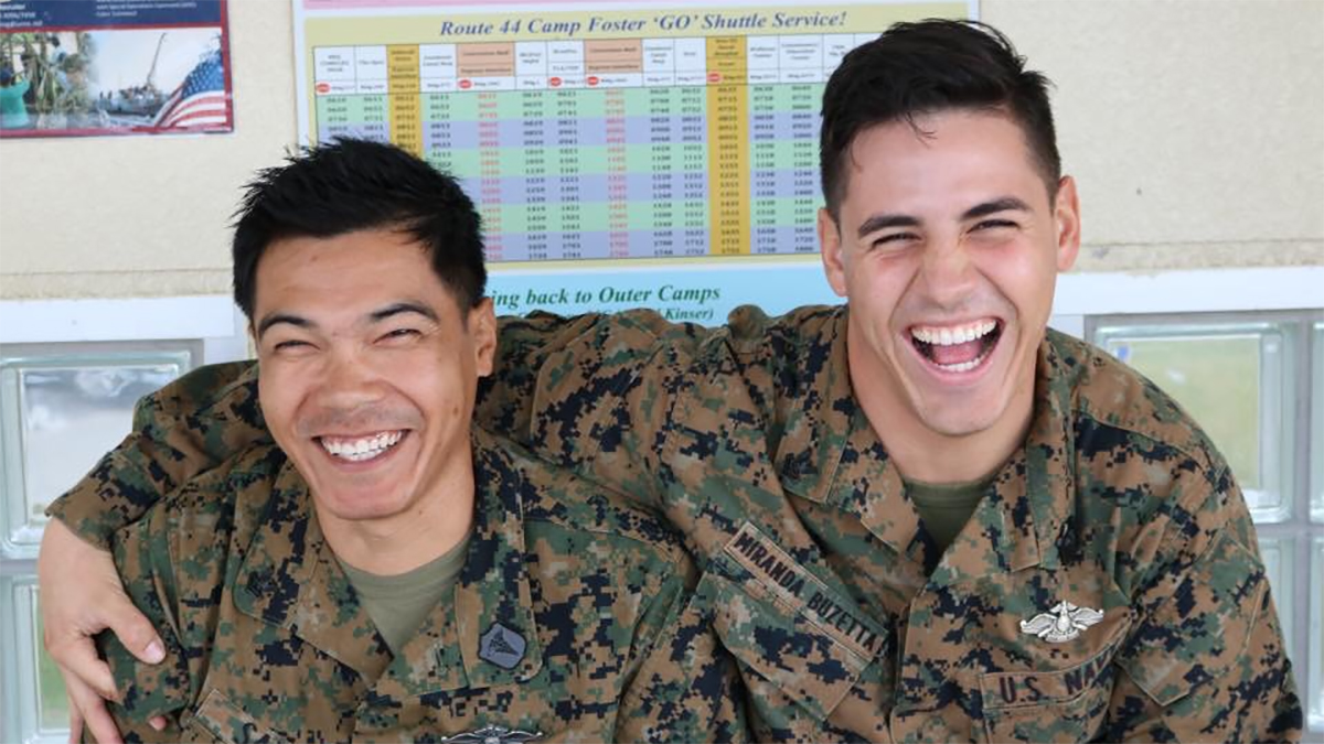 Abel in military uniform smiles with his arm around friend and fellow hospital corpsman