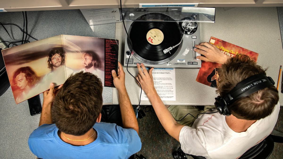 students listen to a record player.