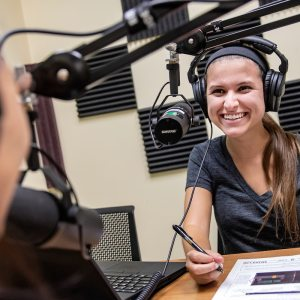 A student hosts a podcast.