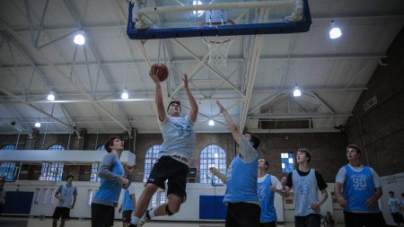 Men play basketball