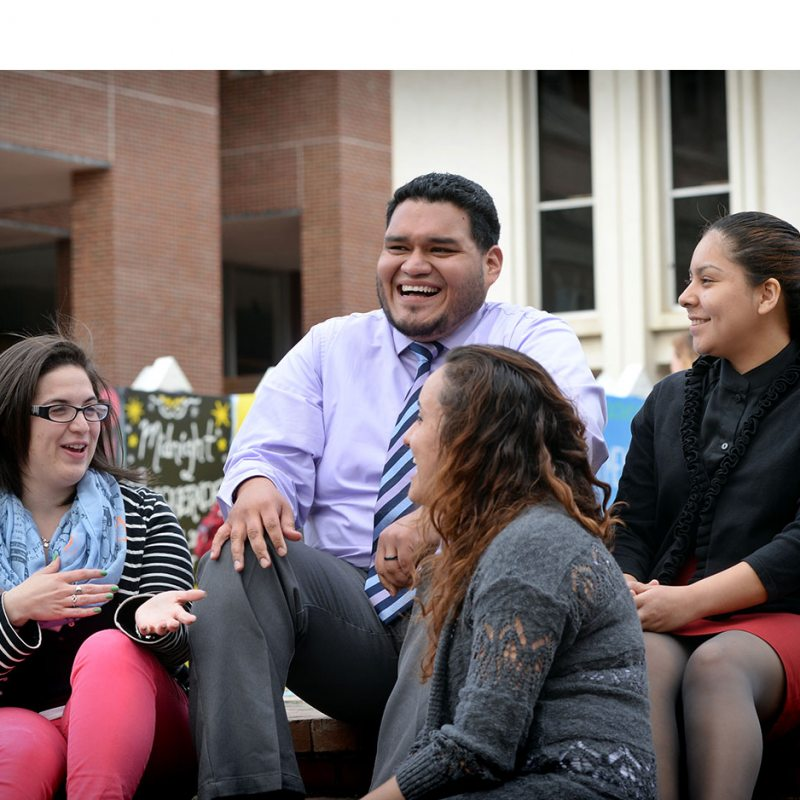 Josmell Perez sits with students in the pit.
