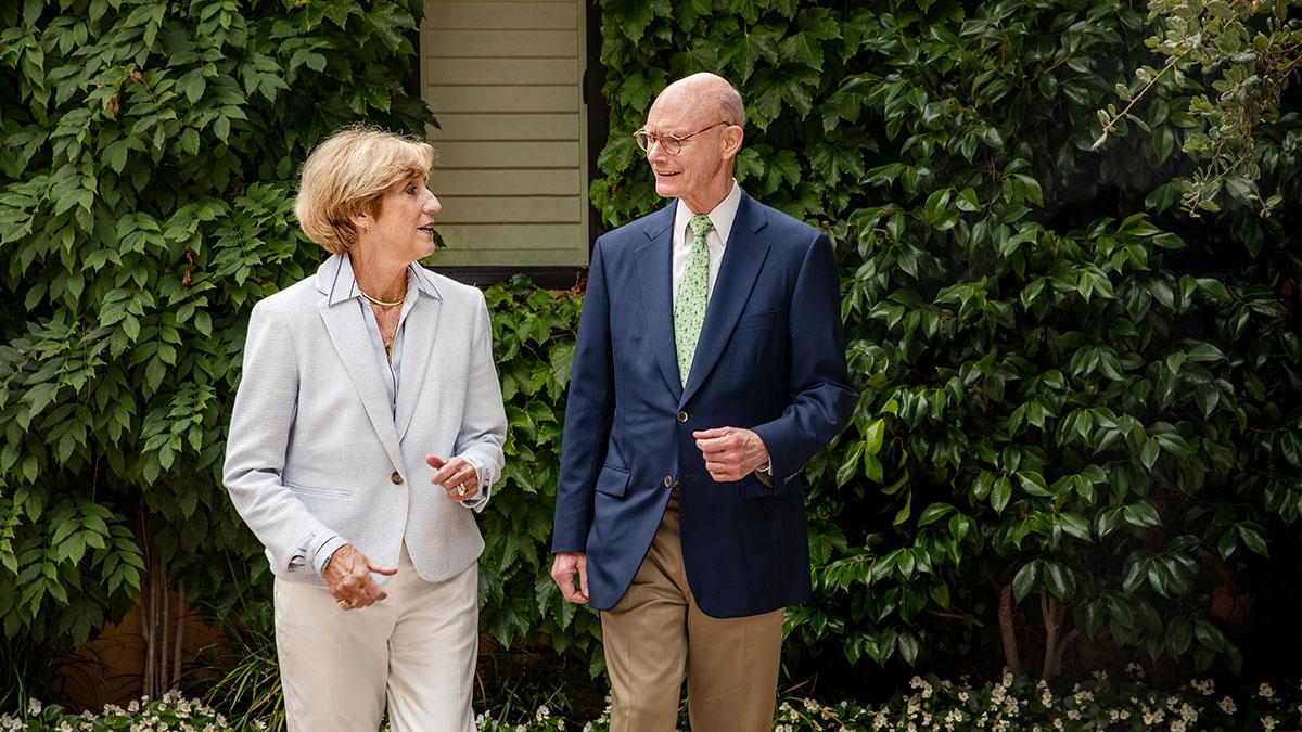 Susan King walks with Walter Hussman.