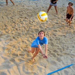 A woman playing volleyball