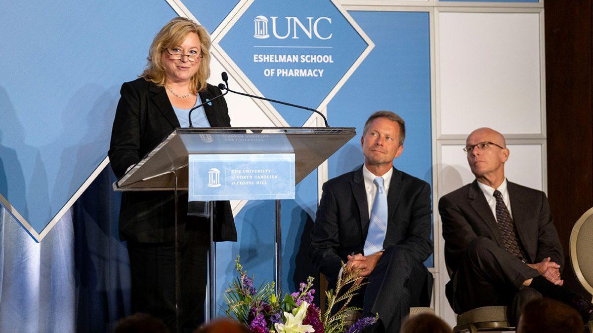 Angela Kashuba speaks on stage.