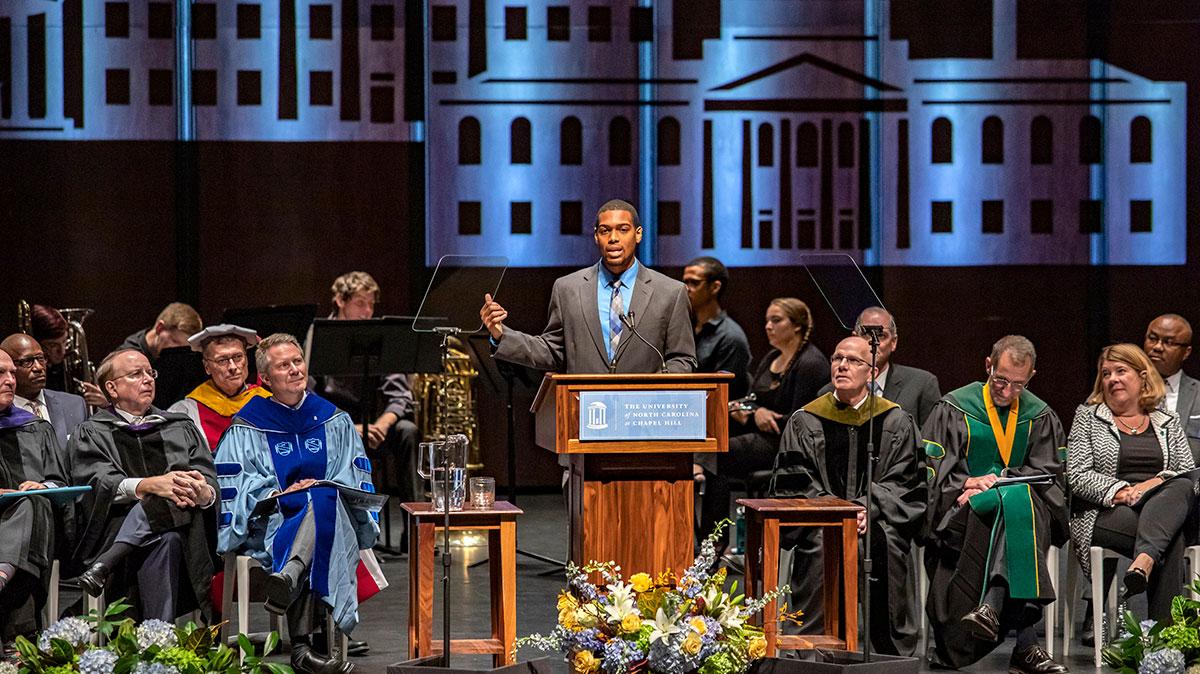 Nehemiah Stewart speaks at stage during University Day.