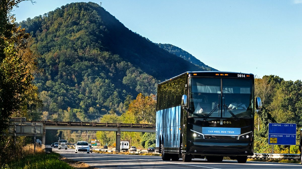 The Tar Heel Tour Bus drives through the mountains.