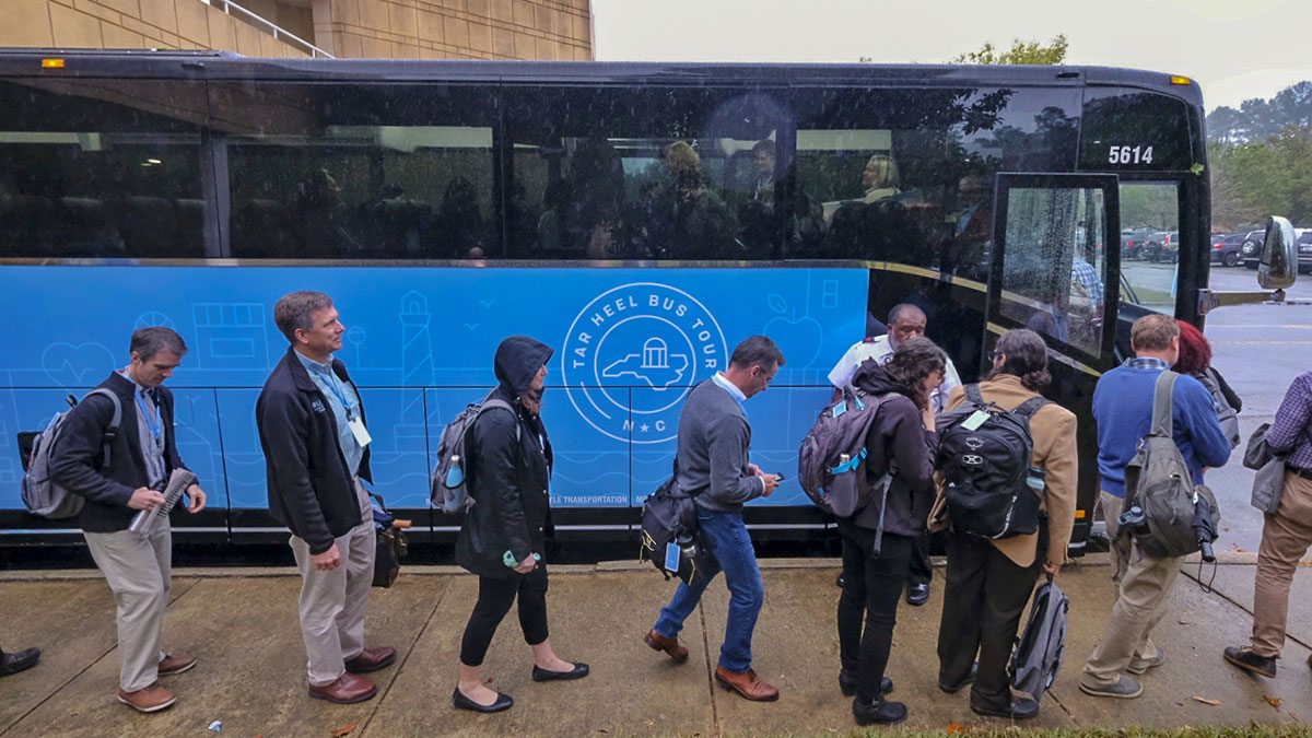 Participants load onto the bus at the Friday Center.