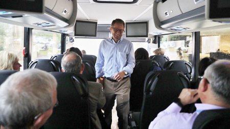 Kevin Guskiewicz walks onto a bus.
