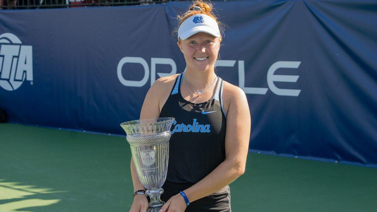 Sara Daavettila holds a trophy.