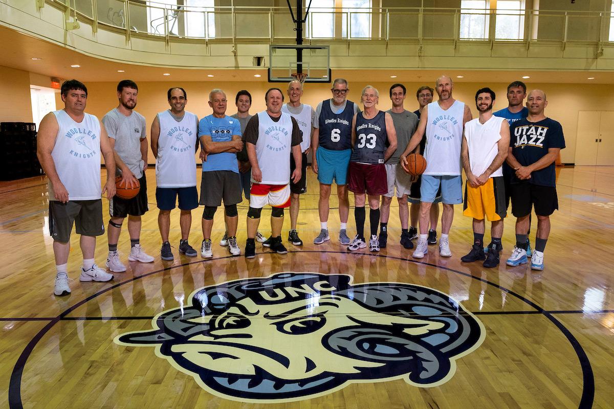 Center before a game. From left to right are Brent Cooper, Logan Poe, Kenan, Jack, Jip Richards, Gary, Tony, Peter, Mike, Robert Hutchins, Robert Stewart, Tom, Evan Vitiello, Jeremy Warren, Adam Zinn.
